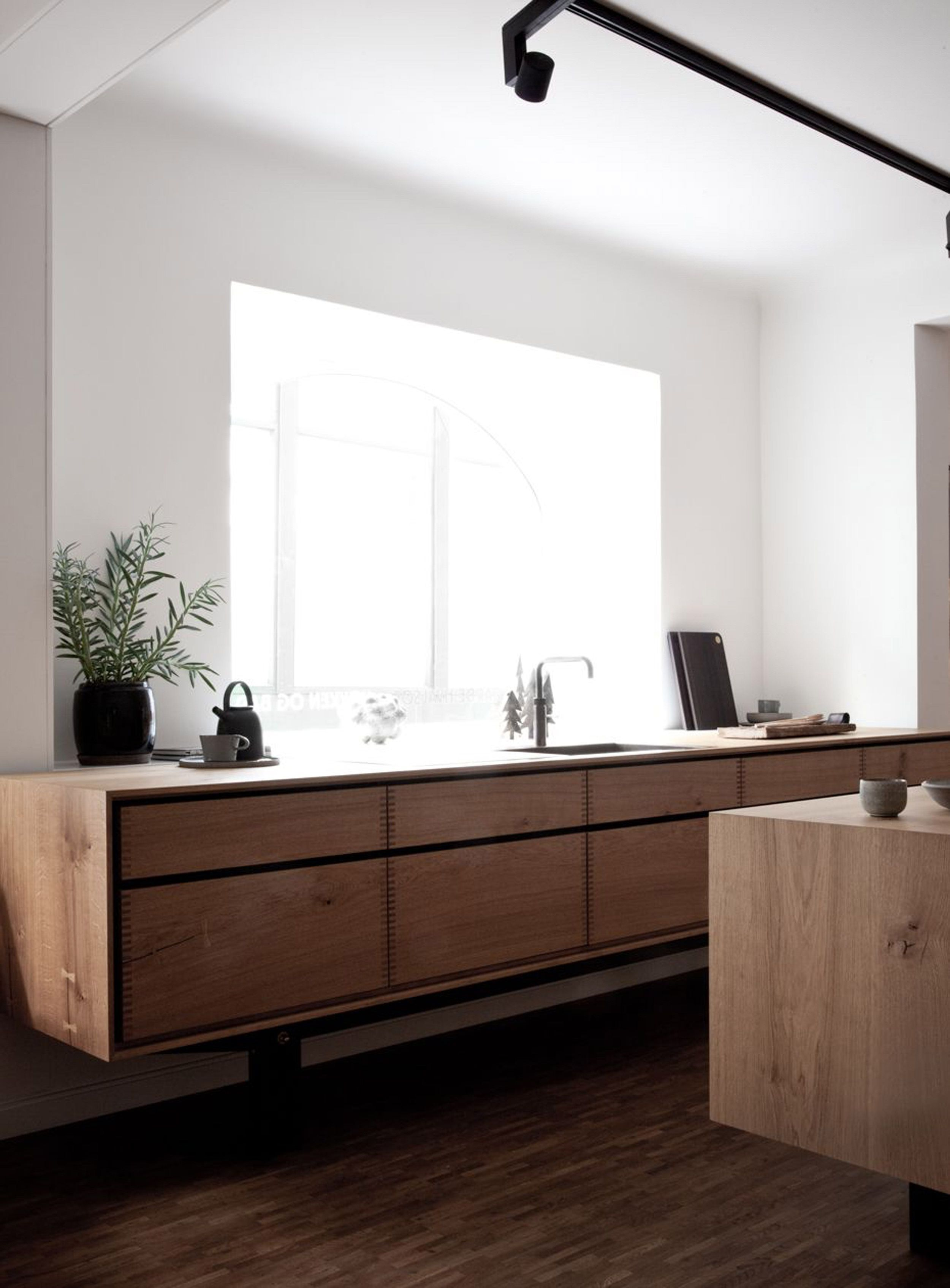kitchen, wooden floor, wooden floating cabinet, white wall