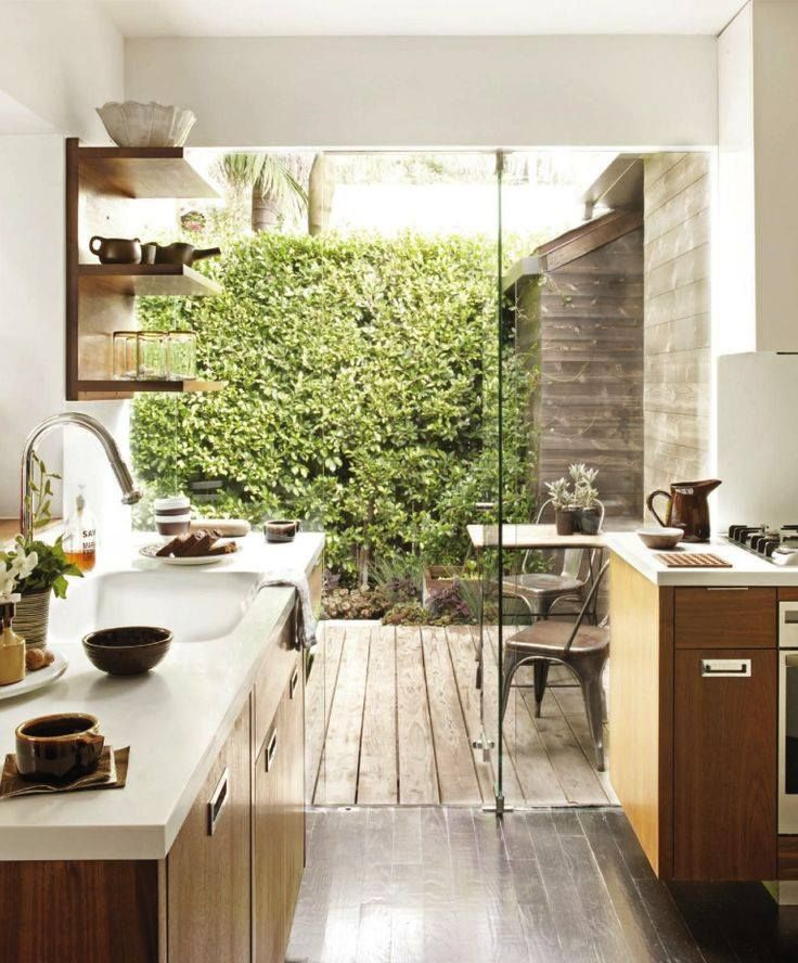kitchen, wooden floor, wooden patio floor, white wall, wooden cabinet with white top