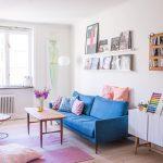 Light Blue Velvet Sofa, Wooden Floor, White Wall, Wooden Coffee Table, White Cabinet, White Floating Shelves