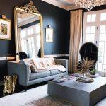 Living Room, Black Floor, Grey Rug, Black Wall, Grey Sofa, Grey Square Coffee Table, Crystal Chandelier, Black Round Chair, Golden Framed Mirror