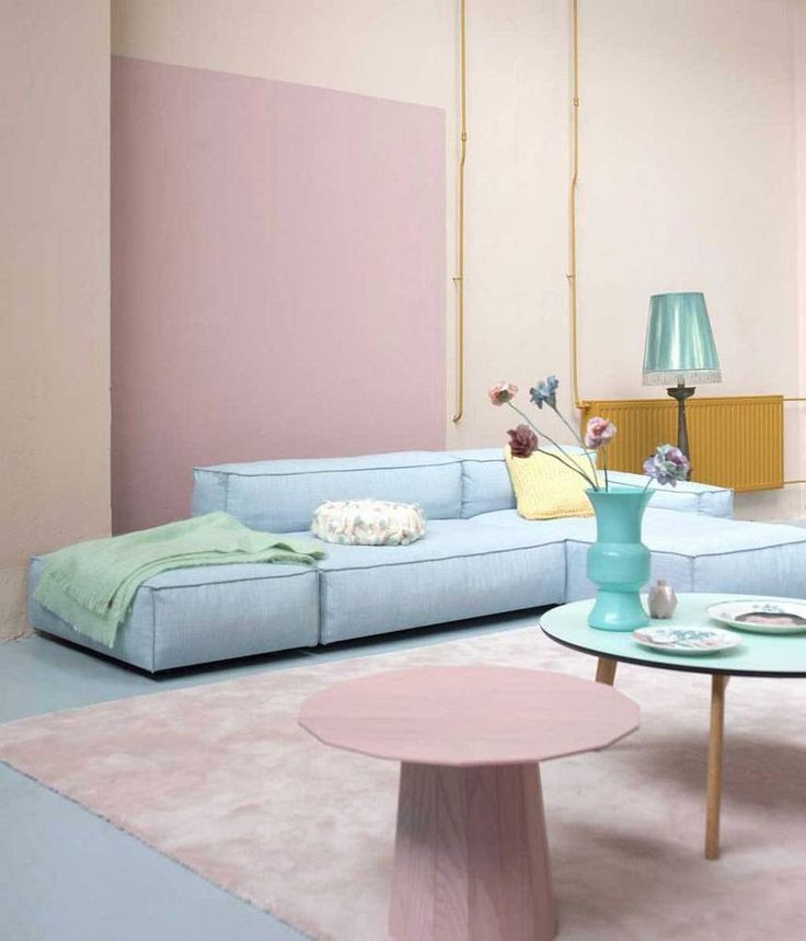 living room, blue floor, yellow wall, pink wall, blue floor sofa, pink round coffee table, blue round coffee table