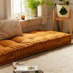 Living Room, Brown Concrete Floor, Brown Rug, Mustard Cushion