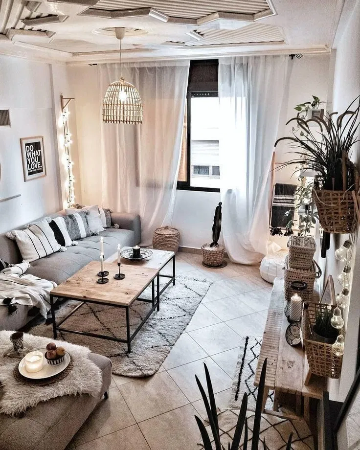 living room, brown floor, white wall, grey sofa, grey ottoman, wooden coffee table, wooden console table, rattan accessories