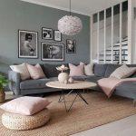 Living Room, Brown Wooden Floor, Rattan Rug, Grey Wall, Grey Velvet Corner Sofa, Round Wooden Table, White Pendant, Rattan Ottoman
