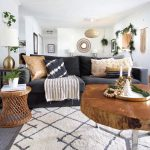 Living Room, Grey Floor, White Rug, Black Sofa, Wooden Coffee Table, Rattan Side Table, Wooden Side Table, White Table Lamp