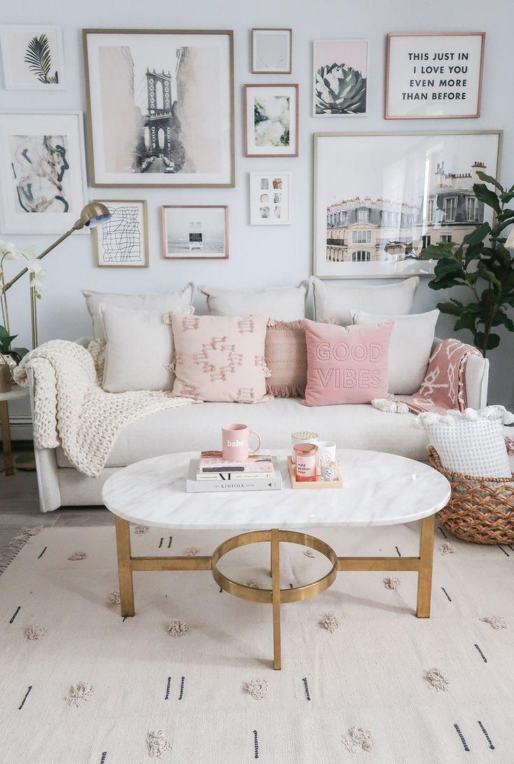 living room, grey floor, white rug, white sofa, white wall, white marble coffee table, golden floor lamp