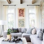 Living Room, Grey Rug, Grey Sofa, Light Grey Coffee Table, White Wall, White Curtain, White Floor Lamp, Pillows, Wooden Ceams On The Ceiling