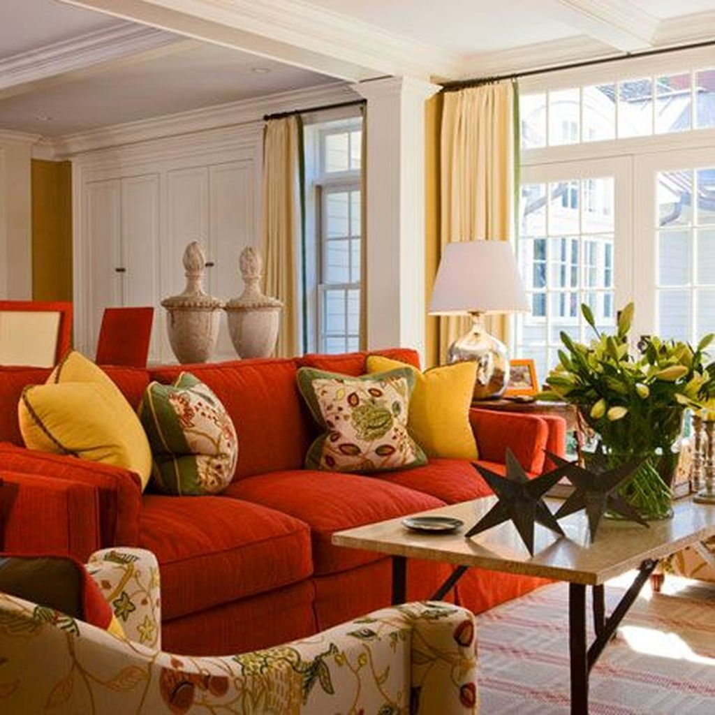 living room, red sofa, patterned chair, white wall, yellow curtain, table,