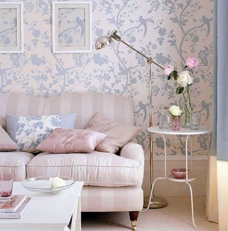 living room, soft pink wallpaper, soft pink striped sofa, white coffee table, golden floor lamp, white side table, pink rug