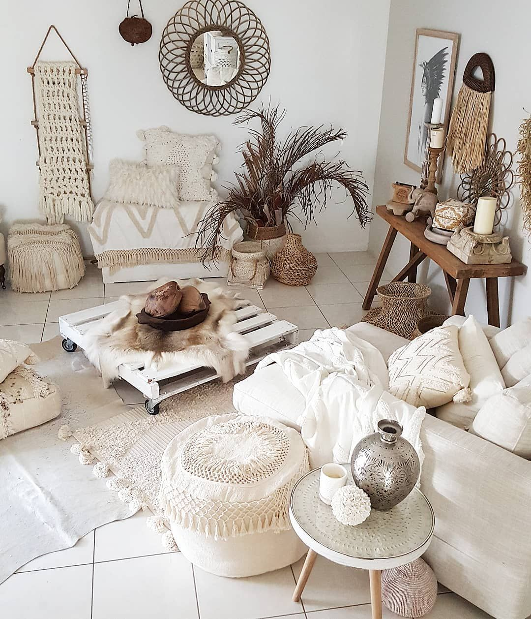 living room, white floor, white wall, white lounge chair, white wooden coffee table, wooden console table, white ottoman, plant accessories