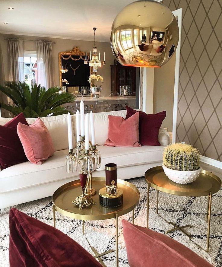 living room, white rug, golden tray table, white sofa, pink pillows, golden pendant,