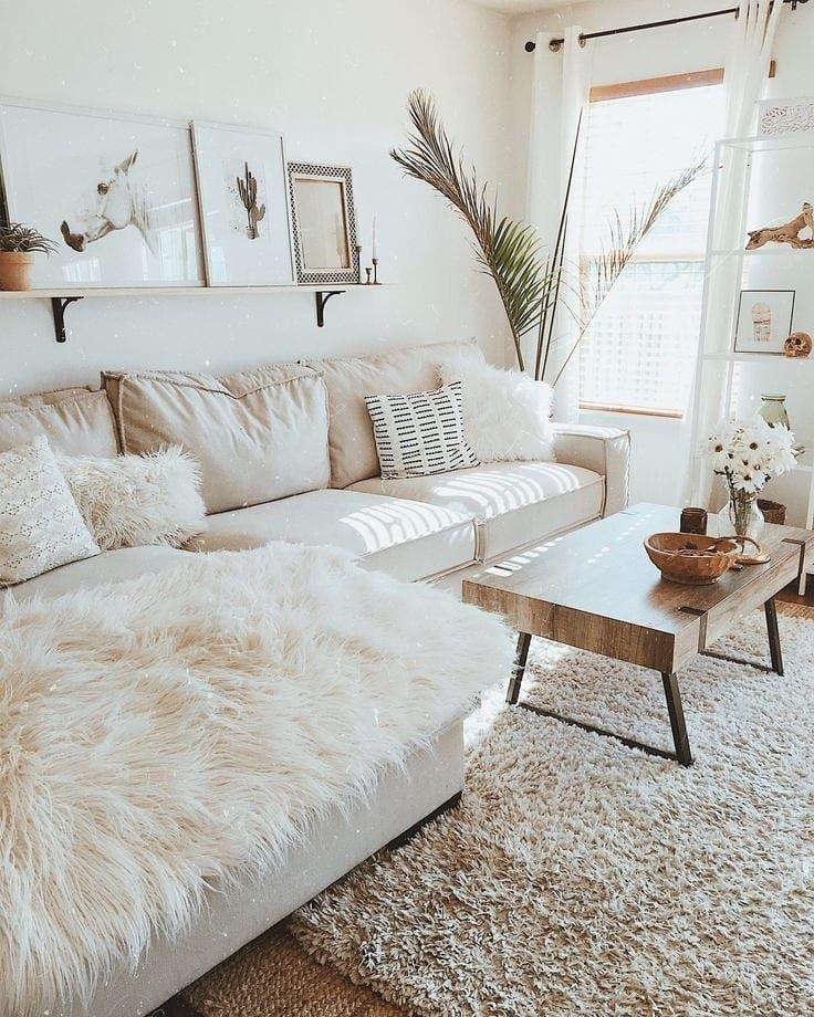 living room, white rug, white corner sofa, white rug, wooden coffee table, floating shevles