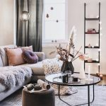 Living Room, White Wall, Woodenf Loor, Grey Rug, Grey Corner Sofa, Round Coffee Tbale, Black Ottoman