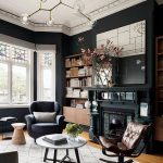 Living Room, Wooden Floor, Black Wall, Black Chair, Dark Grown Leather Chair, White Round Coffee Table, Black Fireplace, White Framed Window