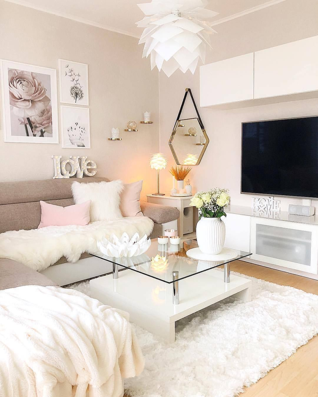 living room, wooden floor, cream wall, white top cabinet, white console table, grey sofa, glass top coffee tbale, white rug, white pendant