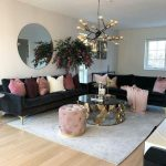 Living Room, Wooden Floor, Grey Rug, Brown Wall, Black Sofa, Golden Coffee Table, Black Pendnat With Golden Bulbs, Pink Tufted Ottoman