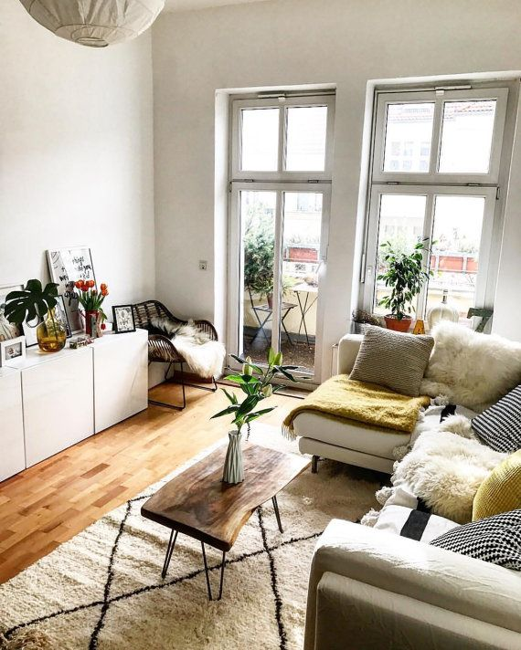 living room, wooden floor, white cabinet, white corner sofa, wooden coffee table, black chair