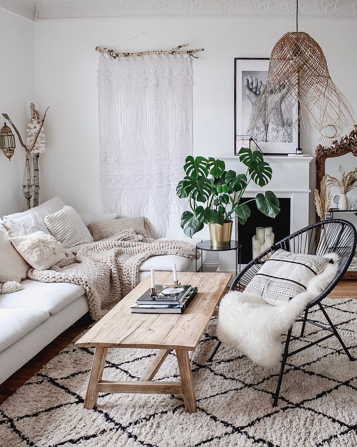 living room, wooden floor, white rug, black rattan chair, white sofa, wooden coffee table, rattan pendant