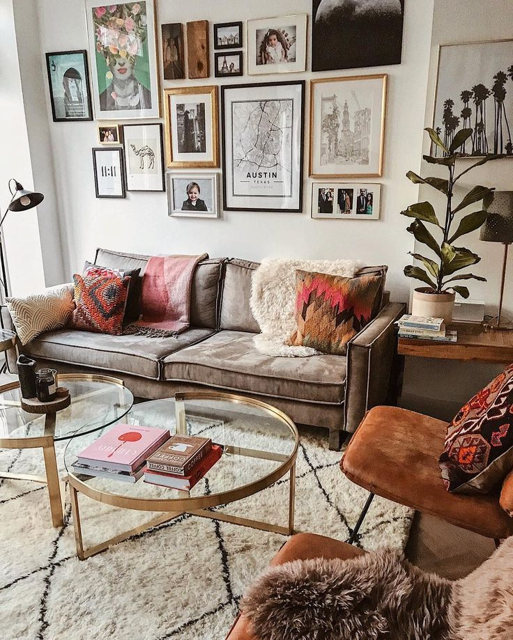living room, wooden floor, white rug, glass round coffee table, white wall, brown sofa, brown velvet chairs, wooden side table, floor lamp