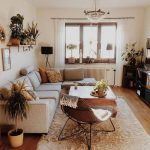 Living Room, Wooden Floor, White Rug, Wooden Coffee Tbale, Brown Leahter Chair, Grey Corner Sofa, Chandelier, White Wall