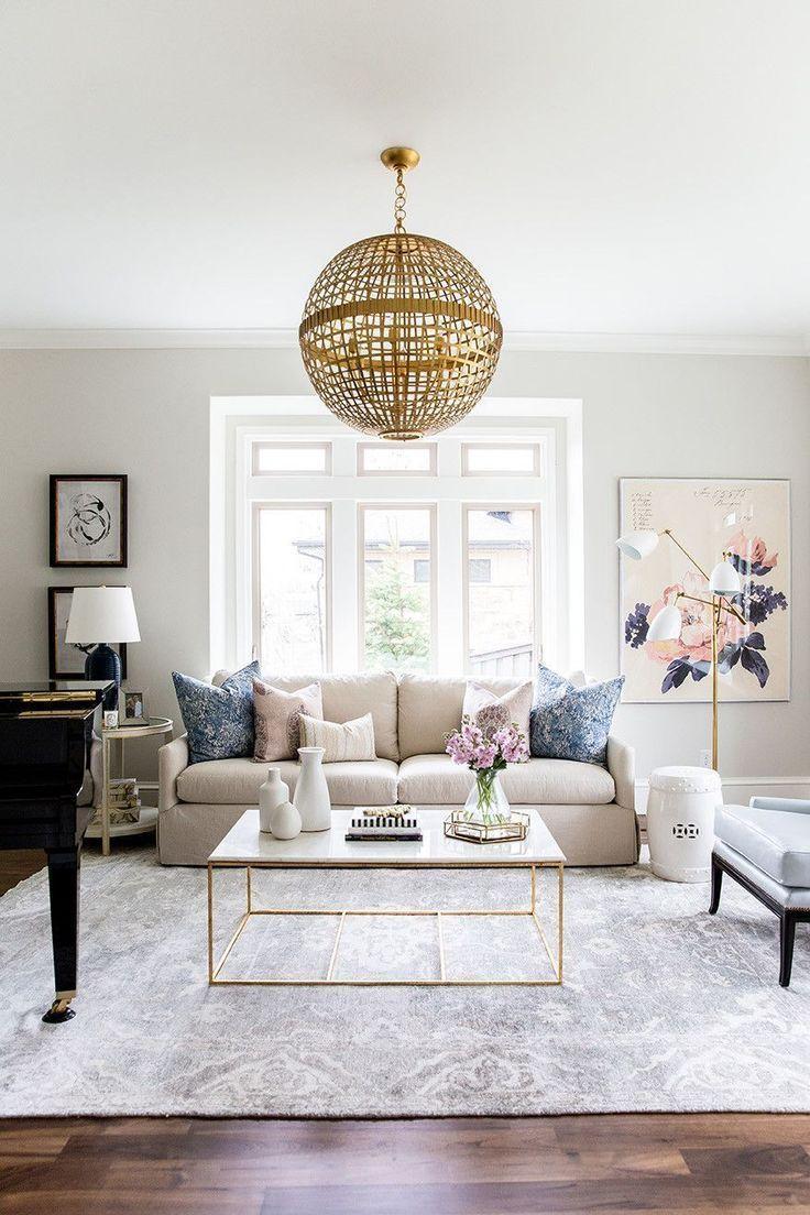 living room, wooden floor, white sofa, white marble coffee table, golden pendant, leather chair, white floor lamp