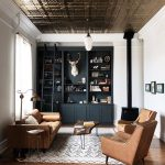Living Room, Wooden Floor, White Wall, Black Built In Shelves, Ceiling Lamp, Brown Leather Sofa, Brown Leather Chairs, Coffee Table