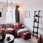 Living Room, Wooden Floor, White Wall, Black Shelves, Grey Corner Sofa, Round Coffee Table, Purple Ottoman, Modern Pendant