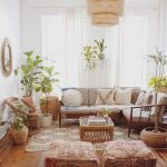 Living Room, Wooden Floor, White Wall, Wooden Sofa, White Cushion, White Pillows,rattan Chairs, Rattan Coffee Table, Patterned Rug, Rattan Pendant, Ottomans