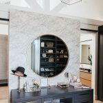 Make Up Station, Wooden Floor, White Marble Wall, Grey Cabinet With Golden Handler, Round Mirror