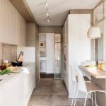 Narrow Kitchen, Brown Floor, White Bottom Cabinet, Brown Backsplash, Brown Top Cabinet, White Cabinet, Wooden Floating Table, White Chairs, White Pendant