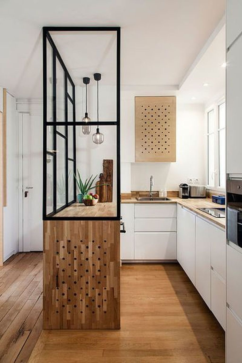 narrow kitchen, white bottom cabinet, white wall, wooden counter top, wooden cabinet, glass partition, pendant