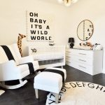 Nursery, Black Wooden Floor, White Wall, White Cabinet, White Rocking Chair, White Ottoman, White Crib, White Round Rug