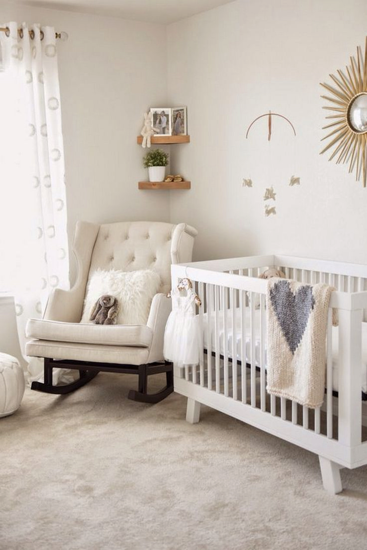 nursery, brown rug, cream wall, white wooden crib, white turfted rocking chair