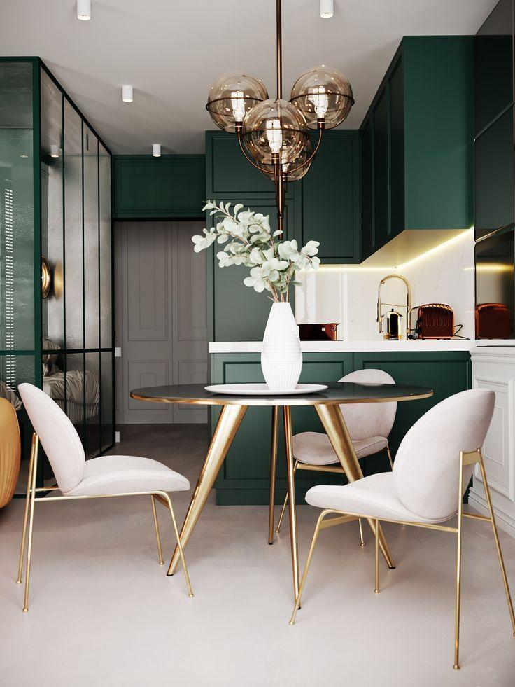 open kitchen, white floor, green cabinet, white backsplash, black round table with golden legs, white chair with golden legs