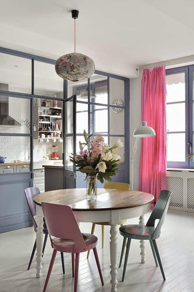 open room, white floor, white subway, white pendant, round wooden table, pastel chairs, grey cabinet, pink curtaib