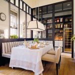 Open Room, Wooden Floor, Black Partition, Glass Partition, White Long Pendant, White Table, Striped Corner Bench, Brown Chairs
