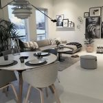 Open Space, Seamless Floor, White Wall, Grey Corner Sofa, Round Table, Round Ottoman, Round Dining Table, Grey Chairs, Pendant,