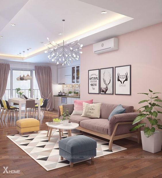 open space, wooden floor, pink wall, wooden sofa with pink cushion, white coffee tbale, yellow and blue ottomans, white dining table, balck yellow chairs