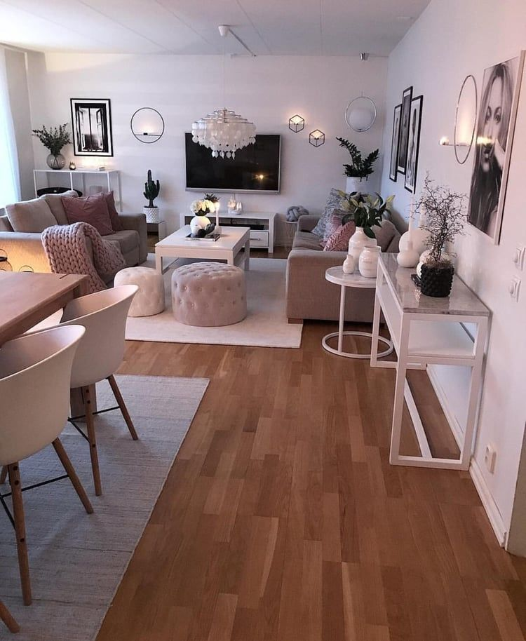 open space, wooden floor, white wall, brown sofa, white chandelier, white wooden coffee table, wooden dining table, modern chairs, white console tbale