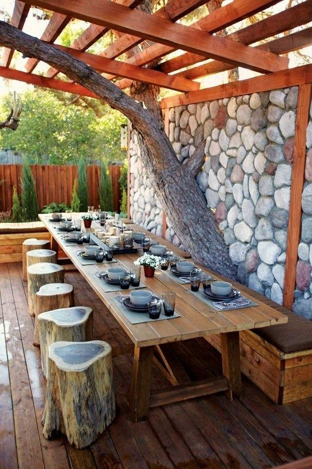 outdoor dining, wooden floor, wooden table, wooden stools, wooden ceiling, stone accent wall, wooden bench