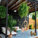 Patio, Blue Patterned Floor, White Corner Sofa, Rattan Swing, Green Coffee Table, Plants