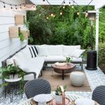 Patio, Patterned Floor, White Wooden Plank, Black Sofa Platform, White Cushion, Round Coffee Table