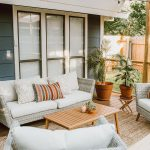 Patio, Wooden Floor, Rattan Rug, Wooden Coffee Table, White Rattan Chairs, White Cushion, Plants