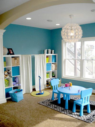 playroom, brown rug, white shelves, blue study table and chairs, fun pendant, blue wall