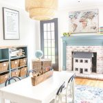 Playroom, Wooden Floor, White Wooden Wall, White Kids Study Table And Chairs, Blue Shelves, Rattan Baskets, Blue Fireplace, Rattan Pendant