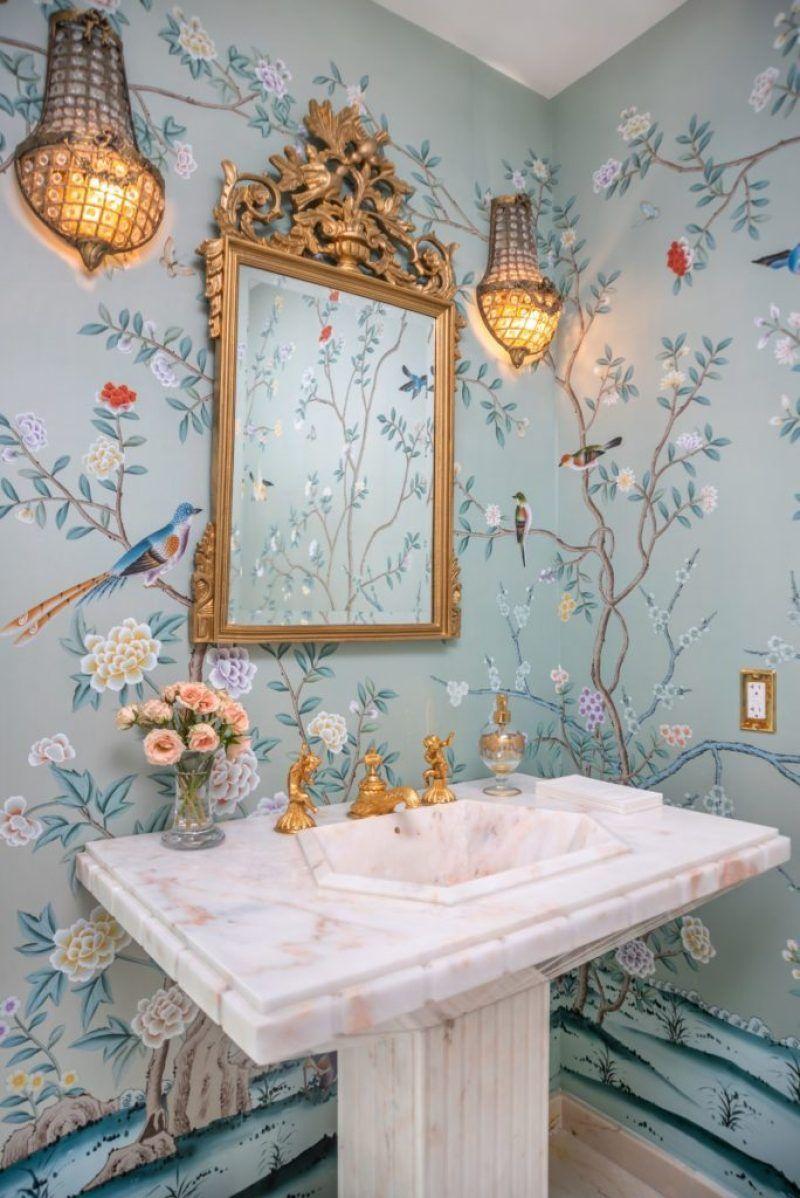 powder room, blue wallpaper, golden framed mirror, golden sconces, white marble sink