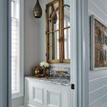 Powder Room, White Wainscot Vanity, Grey Marble, Grey Wall, Golde Faucet, Wooden Door For Mirror, Black Pendant