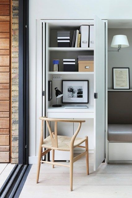 small cabinet, white shelves, white floating table, brown wooden chair