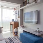 Small Living Room, White Floor, White Cabinet, TV, Blue Tufted Bench, White Sofa, Patterned Sofa, Floating Shelf, Chair, Cabinet
