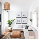 Small Living Room, Wooden Floor, White Wall And Ceiling, White Corner Sofa, Brown Leather Ottoman, Rattan Pendant, Patterned Rug
